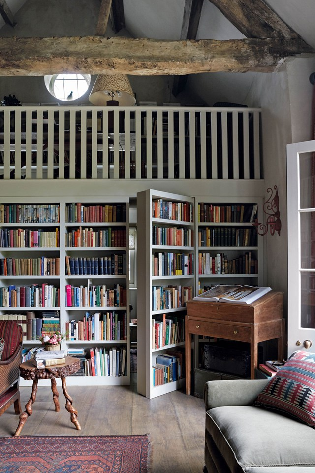 Shabby room interior with mini library and secret bookcase d.